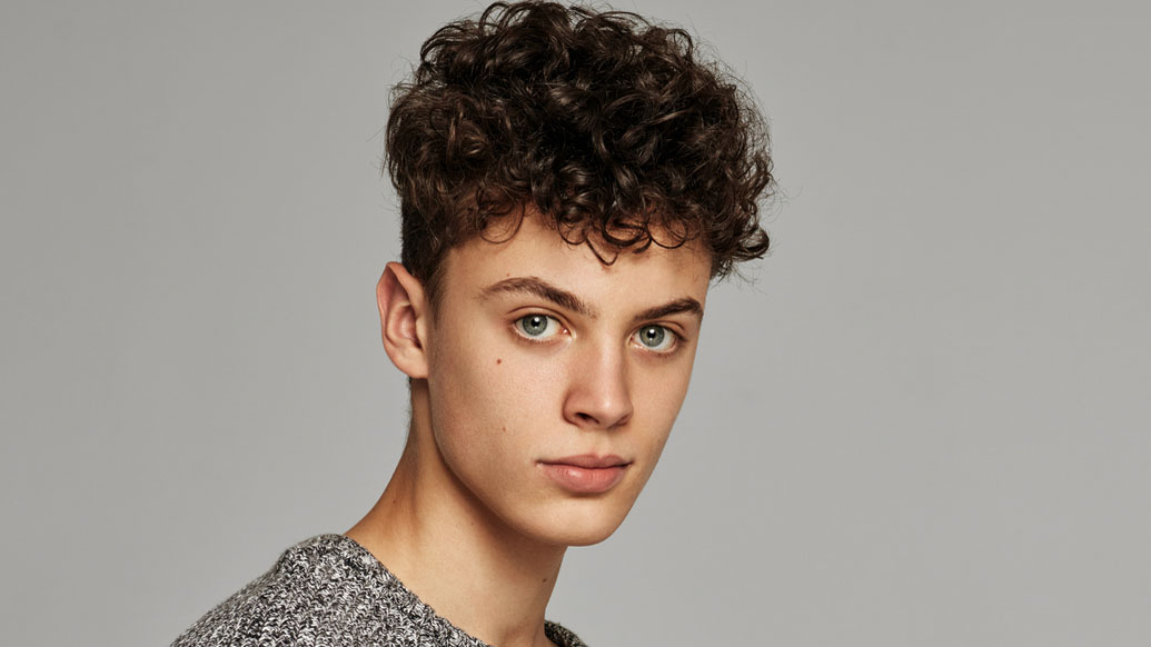 The male perm is one of this year's top men's hair trends, here's how to nail the curly look